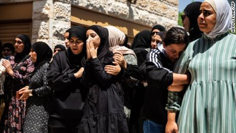 Mourners react during the funeral of Israeli Arab Khalil Awaad and his daughter Nadine, 16, in the village of Dahmash near the Israeli city of Lod, on Wednesday.