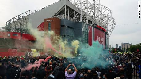 Manchester United fans let off flares as they protest against the Glazer family.