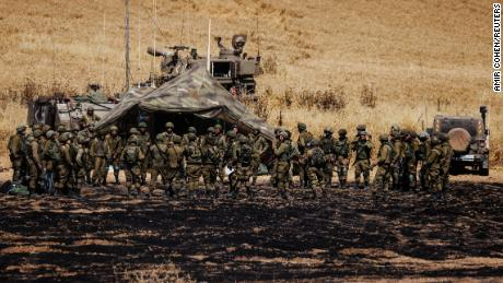 An artillery unit of Israeli soldiers gather on the Israeli side of the border between Israel and Gaza, on May 14.