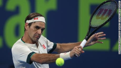 DOHA, QATAR - MARCH 11: Roger Federer of Switzerland plays a backhand during his quarter final match with Nikoloz Basilashvili of Georgia in the Qatar ExxonMobil Open at Khalifa International Tennis and Squash Complex on March 11, 2021 in Doha, Qatar. (Photo by Mohamed Farag/Getty Images)