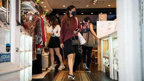 Customers wear masks in the retail shopping district in Manhattan on May 14, 2021