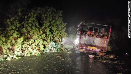 A truck loaded with oxygen bottles got stuck when trees fell in Cyclone Tauktae near Mahuva, Gujarat, India on May 17.