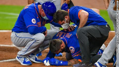 Pillar lays on the ground after being hit by a pitch in the face