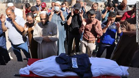 Palestinians attend the funeral of a journalist working for Al-Aqsa radio. The journalist was killed when an Israeli strike hit his home north of Gaza City, on May 19.