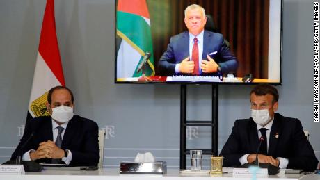 Egyptian President Abdel Fattah el-Sisi, left, and French President Emanuel Macron attend a video conference with Jordan's King Abdullah II ibn Al Hussein, on screen, to work on a ceasefire proposal at the Elysee Palace in Paris, on May 18.