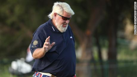Daly reacts after playing his shot on the first hole out of the sand during the first round of the 2021 PGA Championship.