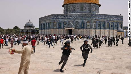 Israeli forces in violent confrontations with Palestinians outside Jerusalem's Al Aqsa mosque after Gaza ceasefire