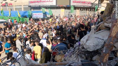 Gaza residents survey damage following days of Israeli airstrikes.