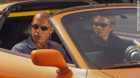 """Actors Vin Diesel  and Paul Walker in a scene from 2001 movie """"The Fast and the Furious."""""""