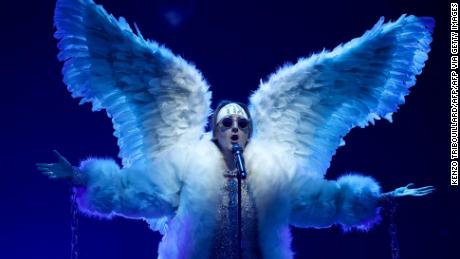 """Tix sings """"Fallen Angel"""" while dressed the part."""