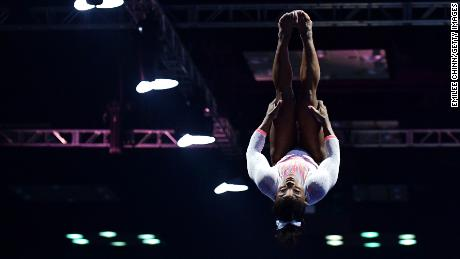 Biles holds a pike position as she performs a historic Yurchenko double pike vault.