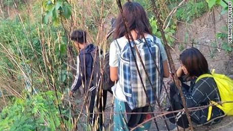 People flee from fighting in Myanmar's northwestern town of Mindat in Chin State, Myanmar, May 17.