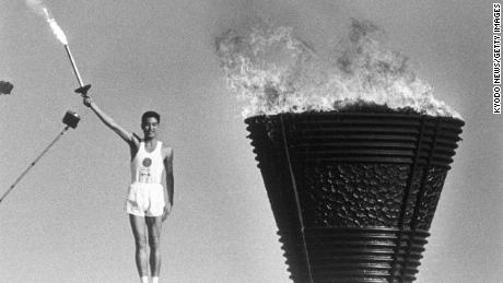 The cauldron is lit during the opening ceremony of the Tokyo Olympics on October 10, 1964.