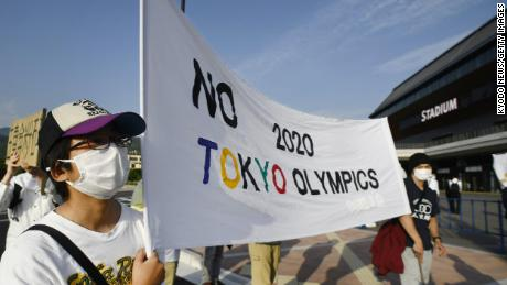 Demonstrators stage a protest against the Tokyo Olympics in the Japanese city of Kameoka on May 25.