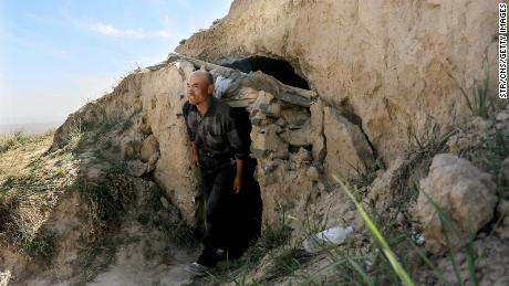 This photo taken on May 24, 2021 shows shepherd Zhu Keming showing the cave dwelling where he sheltered stricken athletes near the city of Baiyin, in China's northwestern Gansu province.