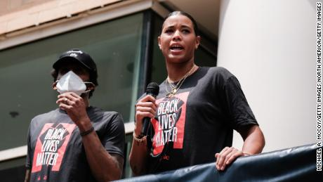Natasha Cloud and Bradley Beal speak at a Juneteenth rally to raise awareness for social justice issues on June 19, 2020 in Washington, DC.