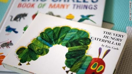 """This photo illustration taken on May 26, 2021, shows Eric Carle's """"The Very Hungry Caterpillar"""" and """"Book of Many Things"""" in Los Angeles, California."""
