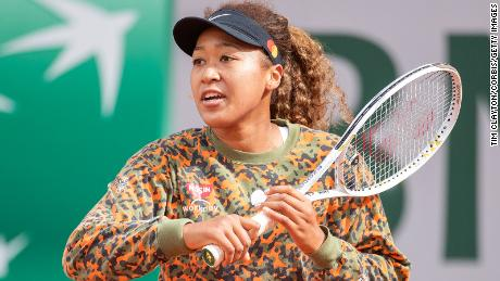 Naomi Osaka of Japan practicing on Court Philippe-Chatrier during a practice match against Ashleigh Barty of Australia  in preparation for the French Open at Roland Garros.