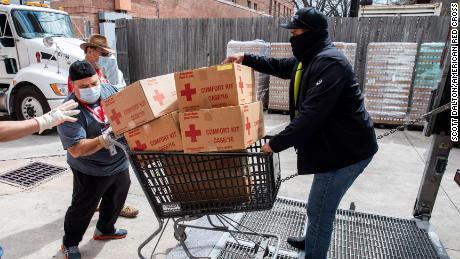 American Red Cross volunteers help move comfort kits in Houston, Texas, on Sunday February 21, 2021.