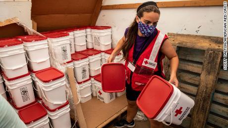 American Red Cross volunteer Casey Garnett unloads emergency cleaning kits after Hurricane Laura, in Georgetown, Louisiana, on Friday, September 4, 2020.