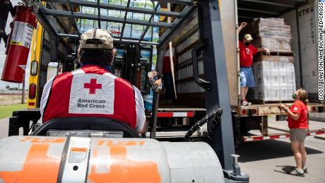 Volunteers for the American Red Cross unload items at warehouse in Mercedes, Texas, on Friday, July 31, 2020.