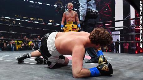 Jake Paul stands over Ben Askren after knocking down the former MMA fighter.