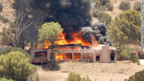 A home burns in the 2600 block of W. Bent Spur Drive in Acton, California, on Tuesday, June 1, 2021.