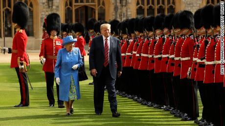 WINDSOR, ENGLAND - JULY 13:  U.S. President Donald Trump and Britain's Queen Elizabeth II inspect a Guard of Honour, formed of the Coldstream Guards at Windsor Castle on July 13, 2018 in Windsor, England.  Her Majesty welcomed the President and Mrs Trump at the dais in the Quadrangle of the Castle. A Guard of Honour, formed of the Coldstream Guards, gave a Royal Salute and the US National Anthem was played. The Queen and the President inspected the Guard of Honour before watching the military march past. The President and First Lady then joined Her Majesty for tea at the Castle.  (Photo by Matt Dunham/WPA Pool/Getty Images)