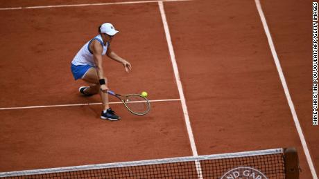 Barty returns the ball to Linette during their women's singles second round match.
