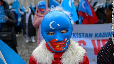 A child from the Uyghur community living in Turkey wears a mask during a protest against the visit of China's Foreign Minister to Turkey, in Istanbul on March 25, 2021.