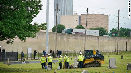 Workers prepare the site where excavation began at Oaklawn Cemetery in a search for victims of the Tulsa Race Massacre believed to be buried in a mass grave, Tuesday, June 1.