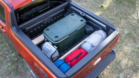 The Ford Maverick's bed has slots that allow wooden planks to be used as dividers for cargo.