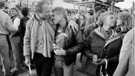 Gary Walsch, who was living with AIDS, leans on a friend's shoulder before a candlelight vigil in San Francisco in 1983. The vigil was held to bring attention to the AIDS crisis affecting the gay community.