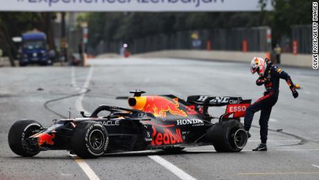 Max Verstappen kicks his tire after crashing out in Azerbaijan.