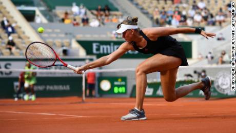 Elena Rybakina returns the ball to Serena Williams of the US during their women's singles fourth round match.