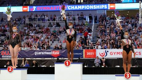 Sunisa Lee, from left, Simone Biles and Jordan Chiles, right, stand on their respective podiums after finishing in the top three following the US Gymnastics Championships, Sunday, June 6, 2021, in Fort Worth, Texas.