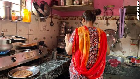 Devika's sister prepares food in the kitchen of their New Delhi home on June 2, 2021.