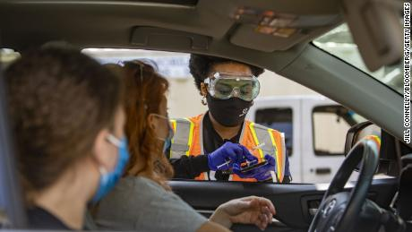 A healthcare worker speaks with a teenager before administering a dose of the Pfizer-BioNTech Covid-19 vaccine at a drive-through clinic at California State University, Northridge on May 13.