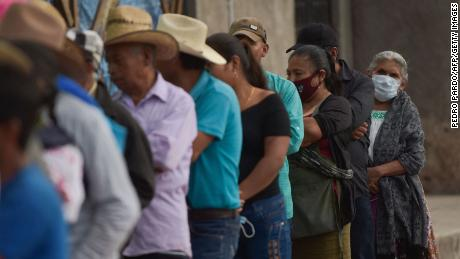 People queue to cast their vote at a polling station in Atzacoalco, Guerrero state, Mexico, on June 6, 2021.