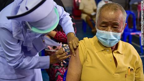 A nurse administers a dose of the AstraZeneca Covid-19 coronavirus vaccine at the Narathiwat Hospital compound in the southern province of Narathiwat on June 7.