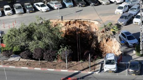 TOPSHOT - A picture shows the scene after a section of a parking lot collapsed into a sinkhole at Shaare Zedek Hospital in Jerusalem on June 7, 2021. (Photo by Gil COHEN-MAGEN / AFP) (Photo by GIL COHEN-MAGEN/AFP via Getty Images)