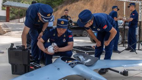 Workers prepare a drone to monitor the migrating wild Asian elephants in Eshan County, Yuxi City, southwest China's Yunnan Province on May 29.