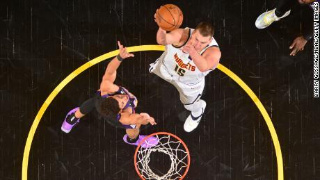 Jokic shoots the ball against the Phoenix Suns.