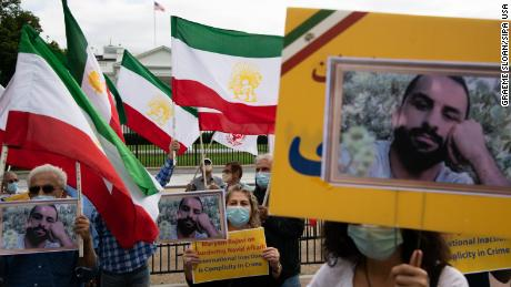 Iranian-American supporters of the National Council of Resistance of Iran (NCRI) protest the execution of wrestler Navid Afkari by Iran, in front of the White House in Washington, D.C. in September 2020.