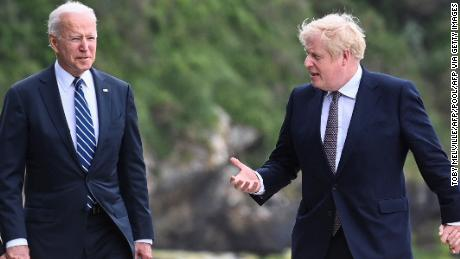 Britain's Prime Minister Boris Johnson (R) speaks with US President Joe Biden while they walk at Carbis Bay, Cornwall on June 10, 2021, ahead of the three-day G7 summit being held from 11-13 June. - G7 leaders from Canada, France, Germany, Italy, Japan, the UK and the United States meet this weekend for the first time in nearly two years, for the three-day talks in Carbis Bay, Cornwall. - (Photo by TOBY MELVILLE / POOL / AFP) (Photo by TOBY MELVILLE/POOL/AFP via Getty Images)