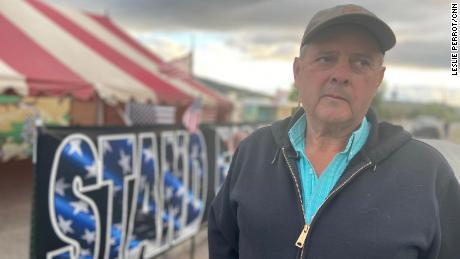 """Local farmer Dan Nielsen stands outside the tent set up next to the main headgate called """"A"""" Canal in Klamath Falls, Oregon."""