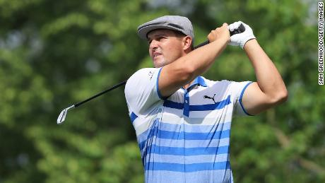 DeChambeau plays his shot from the 14th tee during the first round of The Memorial Tournament.