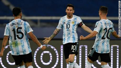 Messi celebrates with teammates Nicolas Gonzalez and Giovani Lo Celso after scoring a free-kick against Chile.