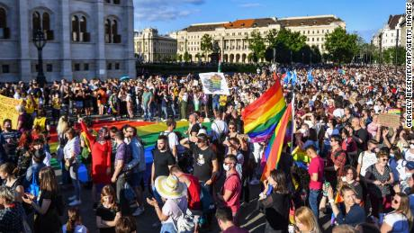 """Participants gather near the Parliament building in Budapest on June 14, during a demonstration against the Hungarian government's draft bill seeking to ban the """"promotion"""" of homosexuality."""