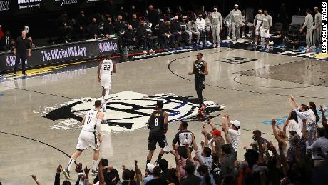 Jeff Green celebrates Durant's three against the Bucks.